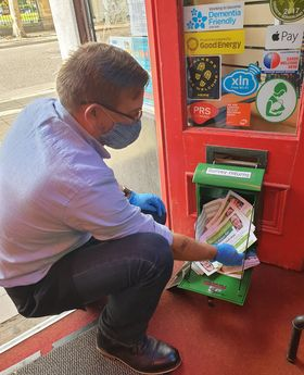 Cllr Mike Isherwood emptying 60 second survey collection box